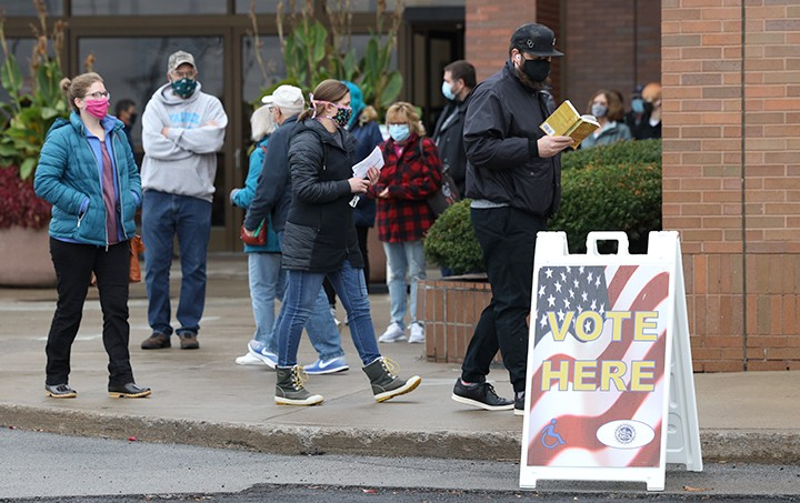 Voters waited outside of the Marketplace Mall polling site for approximately an hour to cast in person ballots Monday afternoon. - PHOTO BY MAX SCHULTE