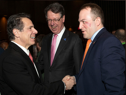 Irondequoit Supervisor Dave Seeley, right, greets Gov. Andrew Cuomo as Brighton Supervisor Bill Moehle looks on in 2019.