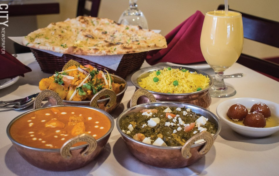 A feast for royals: some Indian cuisine standards, including chicken makhani and palak paneer, at Royal of India. - PHOTO BY JACOB WALSH