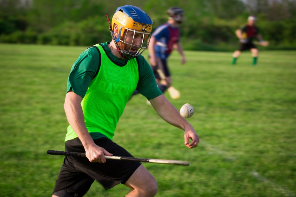 Hurling's equipment: a stick resembling an inefficient canoe paddle and a leather-wrapped cork ball. - PHOTO BY DAVE DEVER AT REVELPIX.COM