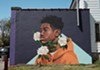 "Brittany Williams' mural ""Through Tragedy, There's Hope"" on the side of Rocky's Pizza on Genesee Street. The piece was a collaboration between Wall\Therapy and Moms Demand Action, a national grassroots organization that pushes for public safety measures."