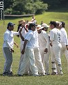 RCC players celebrate an out.