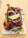 "The hilariously titled ""chicken lollipops"" are just chicken wings marinated with spices, battered, and deep fried."