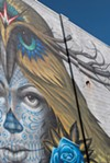 "A detail of the finished mural, ""Love is Sacrifice,"" by Jeff Soto and Maxx242."
