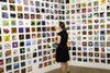 A woman browses artwork during RoCo's annual 6x6 exhibit.