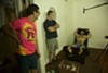 """<p>Director David Farrier, tickle enthusiast Richard Ivey, and willing victim in a scene from the documentary, """"Tickled.""""</p>"""