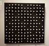 One of the few non-letterform works by Norman Ives represented in the show. This bas-relief sculpture has a black ground with modulated white-tipped pegs.