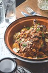 Roux, a restaurant on Park Avenue, puts a spin on French cuisine, like with its chicken tagine dish.