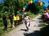 A runner crosses the finish line in a 5K run on El Camino Trail in the city's northeast.