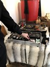 Taddy shows off the Moog oscillator and other equipment that he plays during The Velvet Noose performances.