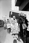 "Jan van Raay's 1971 image ""Faith Ringgold (right) and Michele Wallace (middle) at Art Workers Coalition Protest, Whitney Museum."""