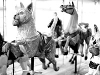 Animals on the carousel? Yes. Racist art, no