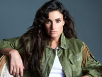 Idina Menzel navigates the stage