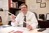 PHOTO BY JACOB WALSH - Kevin Rice, The College at Brockport's energy manager, holds an LED lightbulb.
