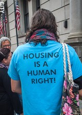PHOTO BY RYAN WILLIAMSON - Housing activist Ryan Acuff outside of the Monroe County Office Building prior to a state Assembly hearing on rental housing and tenant protections.
