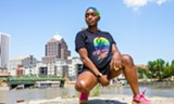 PHOTO BY ADRIAN ELIM - Dominique Monet wearing a Rochester Black Pride t-shirt featuring iconic dancer and choreographer Willi Ninja.