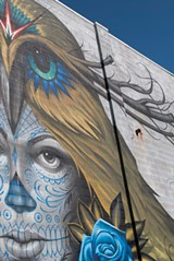 """PHOTO BY REBECCA RAFFERTY - A detail of the finished mural, """"Love is Sacrifice,"""" by Jeff Soto and Maxx242."""