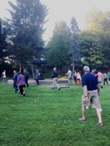 PHOTO BY JAKE CLAPP - Participants in Remote Rochester gather around the fountain in Mt. Hope Cemetery.