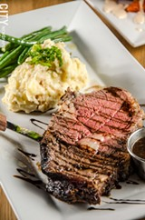 PHOTO BY MARK CHAMBERLIN - Prime rib with mashed potatoes and green beans.