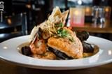 PHOTO BY MARK CHAMBERLIN - Nicolas Grammatico recently opened Black Sheep in Corn Hill Landing, with a focus on French cuisine using fresh, house-made ingredients. Pictured above is the Bouillabaisse, which will always be on the menu, but will change ingredients based on what is fresh and available.