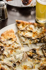 PHOTO BY MARK CHAMBERLIN - The funghi wood-fired pizza.