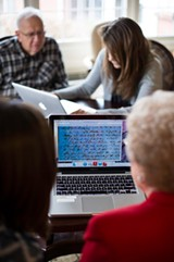 PROVIDED PHOTO - UR students Lauren Davis and Sarabeth Aranbold work with The Highlands at Pittsford residents Lyn Nelson and Allan Anderson on transcribing Seward family letters.