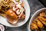 PHOTO BY MARK CHAMBERLIN - The Exchange at Corn Hill recently opened in the former space of Nathaniel's Pub. The restaurant has a pub-centric menu that features (pictured) The New Yorker, a burger with corned beef, caramelized onions, bacon, Swiss cheese, and Thousand Island dressing.