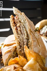 PHOTO BY MARK CHAMBERLIN - The Market Grill at I-Square has a menu heavy with sandwiches and burgers, such as the Cuban.