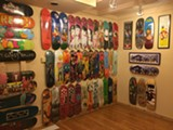 """PHOTO PROVIDED - """"Hoarders of Cool,"""" featuring boards, T-shirts, and other items from the collections of members of the Rochester skateboard community, is on display at AMOR."""