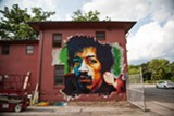 PHOTO BY LISA BARKER - Baltimore artist Earnest Shaw Jr. painted this mural of Jimi Hendrix in the Susan B. Anthony neighborhood as part of Wall\Therapy 2014.