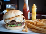 PHOTO BY RYAN WILLIAMSON - Tryon City Tavern recently opened in the Triangle neighborhood, in the space that housed Ellison's. Seen here is the Late Riser burger, with avocado, bacon, cheddar, fried egg, and chipotle mayo.