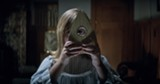 "PHOTO COURTESY UNIVERSAL PICTURES - Lulu Wilson spies something sinister in ""Ouija: Origin of - Evil."""