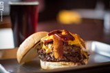 PHOTO BY KEVIN FULLER - JB's Smokehouse opened in East Rochester in June with a menu that has all the meats you'd expect from a barbecue joint. Under the burgers look for the PeJoe Burger (left), which includes grilled ham, pulled pork, bacon, sauce, and cheddar cheese.