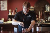 PHOTO BY KEVIN FULLER - Co-owner and Head Distiller Teal Schlegel mixes a Sazerac with Honeoye Falls Distillery rye whiskey.
