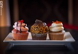 PHOTO BY KEVIN FULLER - Ryan Swift wanted to add an alternative edge to his cakery, Sinful Sweets, so gives his cupcakes names like Lust (left); Holy Night (middle); and Cursed Carrot (right).