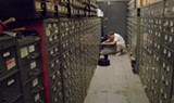 "PHOTO COURTESY KINO LORBER - Archivist Jeff Roth mans the New York Times ""morgue"" in the - documentary ""Obit."""