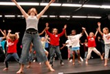 PHOTO BY CLARKE CONDE - Heather Stevenson leads a class of kids during a Young Audiences of Rochester event. Stevenson is the co-founder of PUSH Physical Theatre and organizes the company's PUSH Pins Performing Arts Camp.