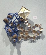 "PHOTO BY REBECCA RAFFERTY - Juan Carlos Caballero-Perez, 'Brooch Patterns"" with sterling silver; 18, 22, and 24k gold; bronze, brown diamond, copper enamel, felt, stainless steel pins, and pearls."