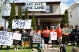 FILE PHOTO - Liz McGriff and members of Take Back the Land stand outside of her home after she reoccupied it in May 2016.