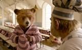 "PHOTO COURTESY WARNER BROS - Paddington - and Knuckles McGinty in ""Paddington 2."""