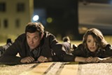 "PHOTO COURTESY WARNER BROS - Jason Bateman and Rachel McAdams in ""Game Night."""