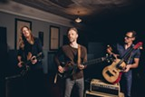PHOTO BY ALYSSE GAFKJEN - The Wood Brothers — (left to right) Oliver Wood, Chris Wood, and Jano Rix — play the Lilac Festival on Friday, May 18.