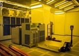 PHOTO BY JEREMY MOULE - AIM Photonics has been installing high-tech equipment in cleanrooms at its Test, Assembly, and Packaging Facility in the ON Semiconductor building.