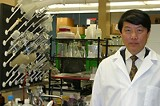 """PHOTO BY KRESTIA DEGEORGE - University of Rochester Professor David Wu in his lab: """"There's both challenge and promise."""""""