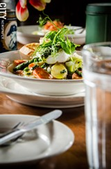 PHOTO BY MARK CHAMBERLIN - Vegetable pot-au-feu, using spring vegetables, poached organic egg, mint pistou, garlic confit toast.