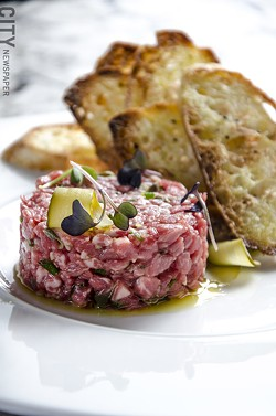 Wagyu beef tartare with toasted crostini. - PHOTO BY MARK CHAMBERLIN