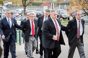 Robert Wiesner (far right) is taken to his arraignment. - PHOTO BY MARK CHAMBERLIN