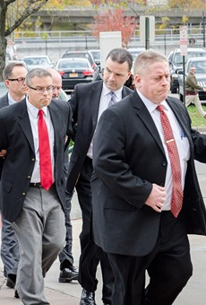 Robert Wiesner (far right) is taken to his arraignment.