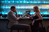 "PHOTO COURTESY WARNER BROS. - Will Smith and Margot Robbie share a drink in ""Focus."""