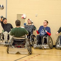 Quad Rugby Wreckers members performing passing and speed drills. PHOTO BY MARK CHAMBERLIN